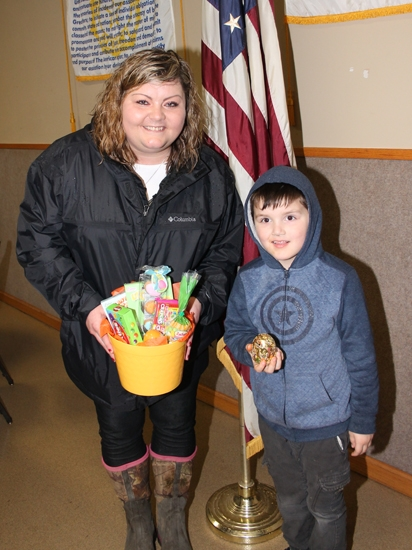 American Legion Post 160 Commander Michelle Amick (left) holds the grand prize - a well-stuffed Easter basket - won by Aiden Roughley at the post's annual Easter Egg hunt on Saturday, April 20.