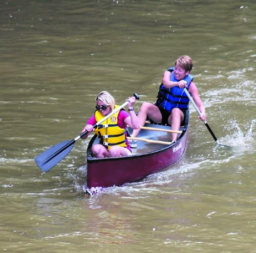 Staci Brown (front) and Jane Trickle navigate their way toward second place in the women's division of the Salamonie Summer Festival Canoe Races in Warren on Sunday, July 7.