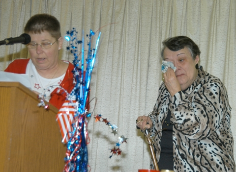 Mary Emma Holmes (right), the 2009 Samuel L. Jones Pioneer Award winner, wipes away a tear as 2008 winner Joyce Sorg (left) reads a tribute to Holmes during the award breakfast Thursday, July 2, at the Knight Bergman Center in Warren.