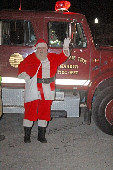 Santa Claus, shown here on his arrival in Warren last year, will arrive in the town Friday evening, Nov. 24, and kick off the holiday season with the lighting of the town Christmas tree.