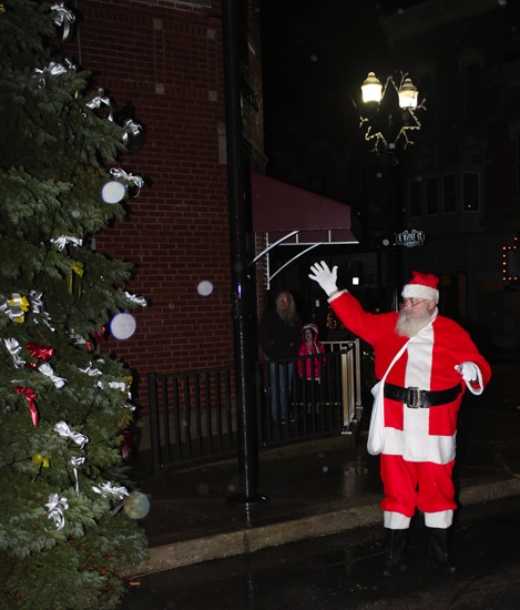 Santa Claus uses some Christmas magic to oversee the lighting of the Warren town Christmas tree last year during the Winter Warrenland festivities in downtown Warren. He will again help light the tree on Friday, Nov. 25, at 6;15 p.m., and is scheduled to be in both Warren and downtown Huntington on Saturday, Nov. 26.