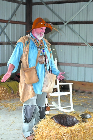 Steve McPhail takes on the character of Johnny (Chapman) Appleseed as he tells a story during the 2011 Forks of the Wabash Pioneer Festival. McPhail will return to this year's festival on Saturday, Sept. 22.