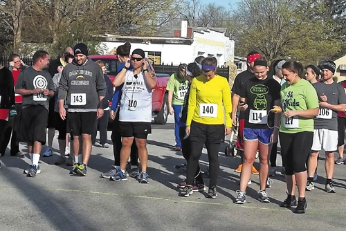 "Runners get ready to go at the start of the 2013 ""5K 4 Kids"" run/walk. The event, which is set for June 7, is a fund-raiser to benefit the Youth Services Bureau."
