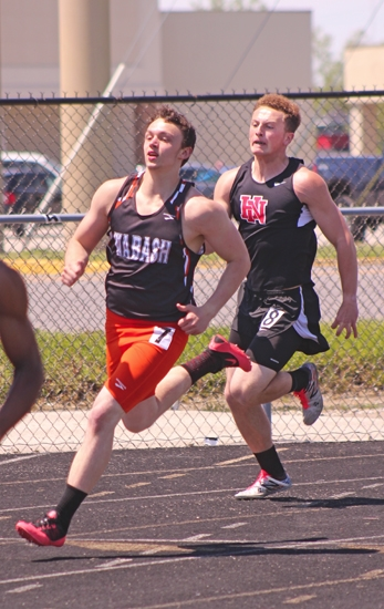 Huntington North's Drew Nash runs the curve in the 200-meter dash at the Huntington North 9/10 Invitational on Saturday, May 13. The Vikings won the meet.