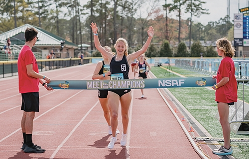Huntington North High School student Addy Wiley crosses the finish line to claim her victory during the National Scholastic Athletic Foundation mile run competition that took place in Myrtle Beach, SC, on Sunday, March 28.