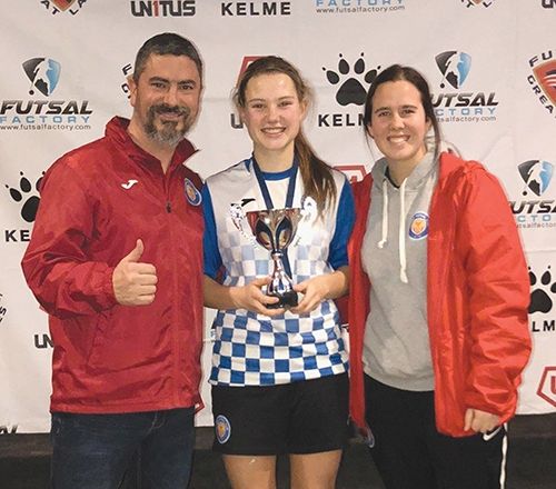 Autumn Anderson (middle), a futsal player from Roanoke, will be playing for the United States at a futsal competition in Medellín, Colombia that is set to begin this week. Futsal is similar to soccer and played indoors. Pictured with Anderson at a tournament this past January are Carlos Cruz (left) and Brianna Cruz, her coaches with the Fort Wayne Phoenix Futsal Club.