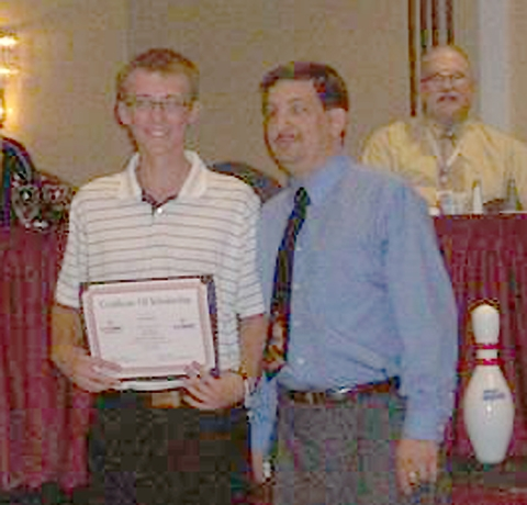 Huntington North varsity bowler EJ Tackett (left) accepts the Kathryn Hotzel Indiana State Youth Bowler of the Year Award recently in Indianapolis.