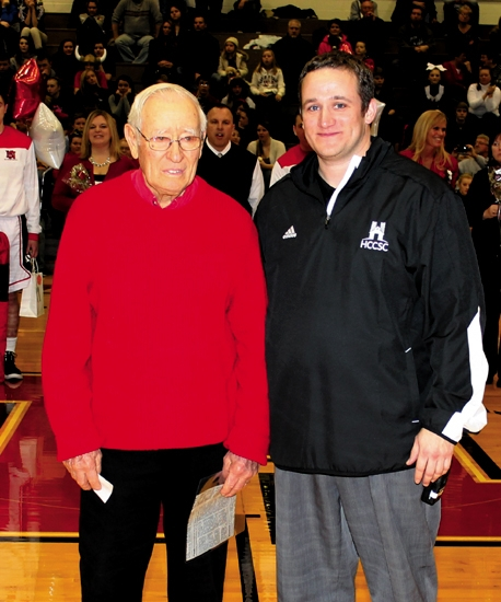 Dean Beaver (left) stands with Huntington North High School Athletic Director Michael Gasaway after making a $1,000 donation to the school's athletic department during a break between a basketball doubleheader at North Arena on Friday, Feb. 7.
