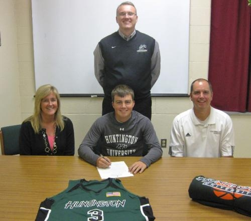 Columbia City High School senior basketballl player Drew Benedict signs a lietter of comittment to attend Huntington University next fall. With Benedict are his parents (front row from left) Chris and Sandy Benedict, and (back) HU Head Coach Ty Platt.