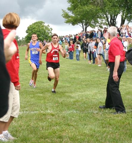 Huntington North High School boys' cross country team runner Josh Graham crosses the finish line in third place at the Huntington North Invitational on Saturday, Aug. 22.