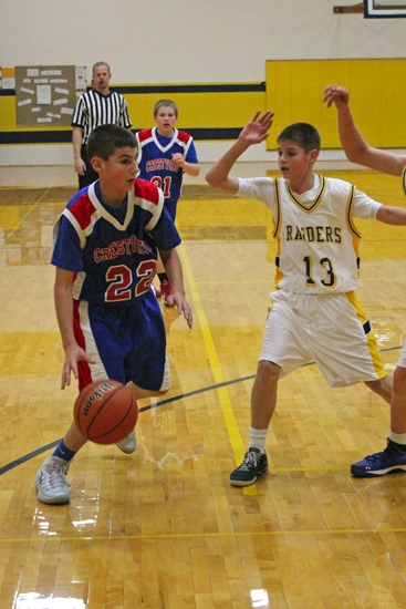 Crestview Middle School seventh grade boys' basketball player Sawyer Stoltz heads toward the basket in action against host Riverview on Tuesday, Dec. 10. CMS won the game, 29-26.