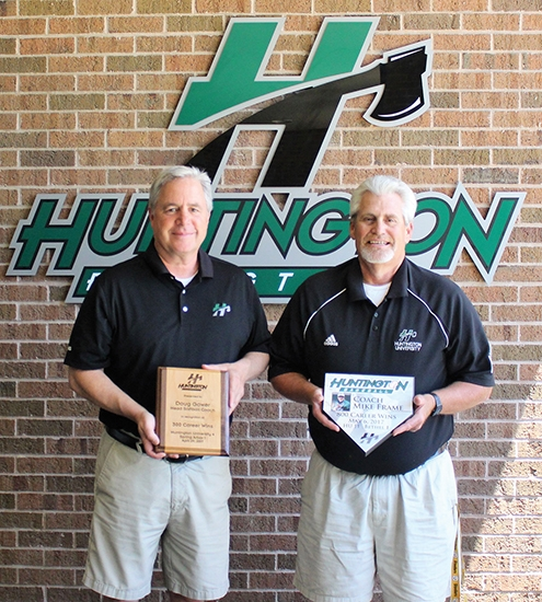 Doug Gower (left) and Mike Frame, head coaches of the Huntington University softball and baseball teams, respectively, hold plaques presented to them by the school for milestones they reached in their coaching careers this past season. Gower picked up his 300th win in April while Frame recorded his 800th victory in May.