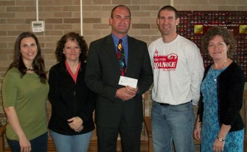 OnTurf Sports presents a check to Roanoke Elementary School PrincipalChris Tillett and members of the Roanoke Elementary School PTO after the running of the Fifth Annual Discover Roanoke run/walk race.