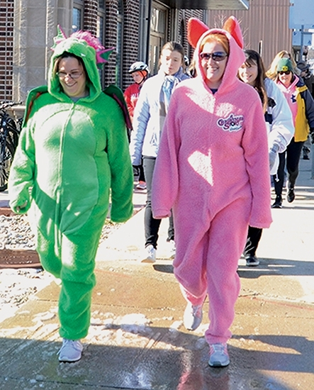 Taking off from Schenkel Station for the start of the HARTA Frigid Encounter on New Year's Day, Wednesday, Jan. 1, 2020, are walkers Stacia Bollinger (left) and Jenny Carr in costumes.