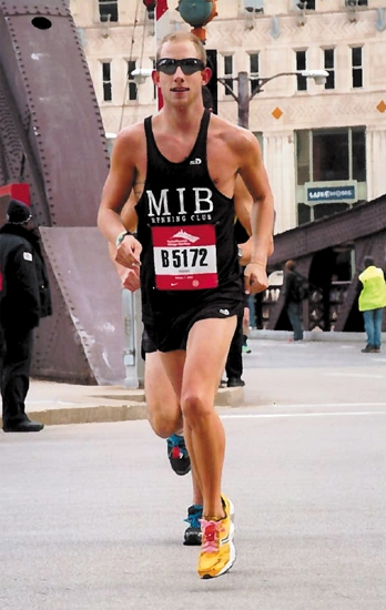 Justin Glancy, of Huntington, runs in the Chicago Marathon in October 2012. Glancy's time qualified him to run in the Boston Marathon, which he will be competing in on Monday, April 15, along with fellow Huntington County resident Susan Zahn.