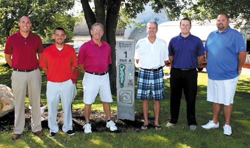 Jeff DuPriest (fourth from left) is the director of the Huntington Invitational Ryder Cup, a tournament that pits a Red Team and a Blue Team, comprised of golfers from both Norwood Golf Course and LaFontaine Golf Club against one another.