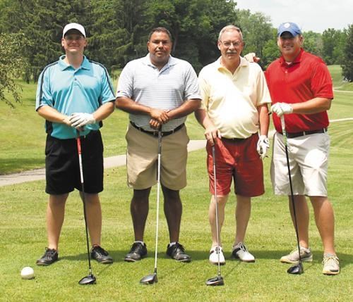 Parkview Huntington Golf Classic team members (from left) Chris Hoke, E.J. Carroll, State Rep. Dan Leonard and Dr. Derek Dyer captured first place at this year's event, which raised funds to support to the purchase of an infant warmer.
