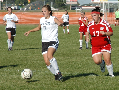 Huntington North High School girls' soccer player Shelby Bradford (front left) concentrates on the ball as she moves past Sara Beyer (right) of Wayne High School during a soccer match Thursday, Sept. 17, on the Huntington North High School field.