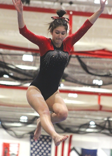 Huntington North High School gymnast Janna Teusch completes her beam routine on Monday, Feb. 8.