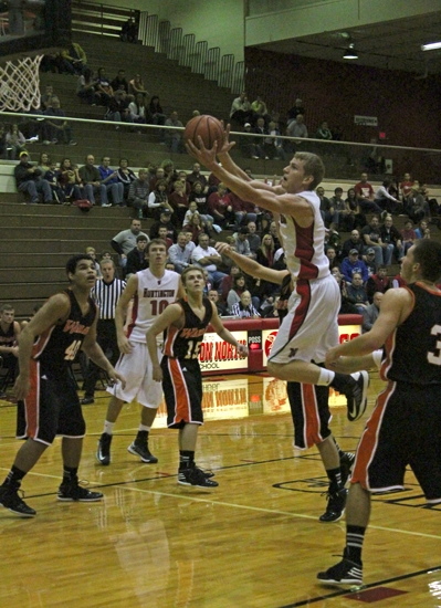 Huntington North's Noah Reed floats toward the hoop to score two of his game-high 22 points against visiting Warsaw on Saturday, Dec. 1. The Vikings won 58-53.