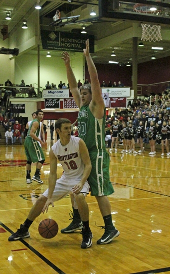 Huntington North's Paul Ehler looks for a cutter as he encounters a New Castle defender down low in action on Saturday night, Jan. 19. The Vikings lost, 66-63.