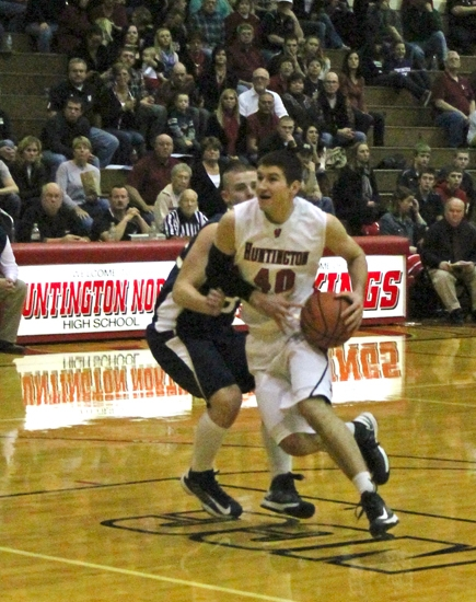 Huntington North's Trenton Kern takes the ball to the hoop against visiting Norwell on Friday, Feb. 22.