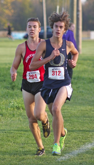 Viking junior Charlie Mettler runs up on the shoulder of Oak Hill's Ryan Miller during the Marion Boys' cross country Sectional on Tuesday, Oct. 9, at Indiana Wesleyan University.