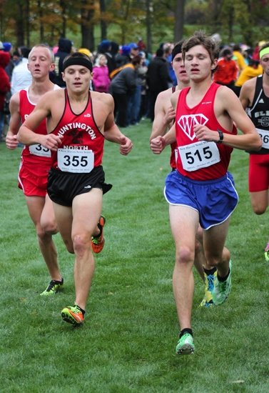 Luke Doughty (second from left), a senior on the Huntington North boys' cross country team, runs alongside teammate Austin Lange (third from left) and West Noble's Brad Pyle (fourth from left) at the New Haven Semi-State, in Fort Wayne, on Saturday.