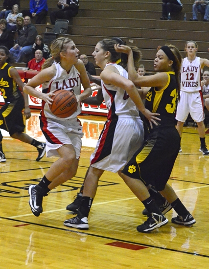 Huntington North guard Allyson Trout (left) uses a pick from teammate Paige Coolman as she maneuvers inside the lane against visiting Fort Wayne Snider on Tuesday, Nov. 20.