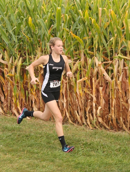 Huntington North sophomore Hannah Stoffel runs besides a cornfield at the DeKalb Baron Classic on Saturday, Aug. 31. Stoffel led the Lady Vikes to a fourth place finish by placing 13th individually.