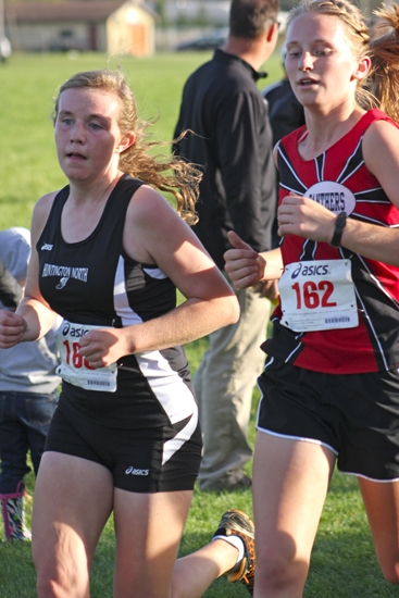 Lady Viking sophomore Emily Eherenman battles with Elizabeth Rodman of Eastbrook during the Marion Girls' Cross Country Sectional on Tuesday, Oct. 9, at Indiana Wesleyan University.