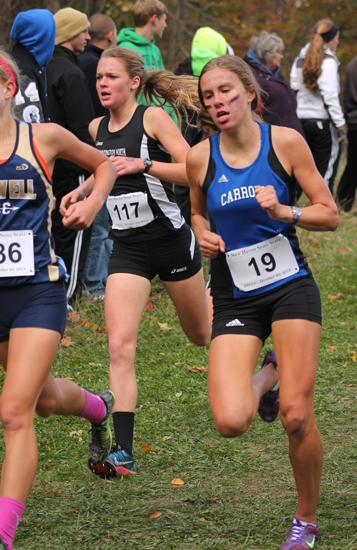 Hannah Stoffel (center), a sophomore on the Huntington North girls' cross country team, runs downhill alongside Carroll's Madison Fruchey (right) at the New Haven Semi-State, at The Plex, in Fort Wayne, on Saturday, Oct. 26.