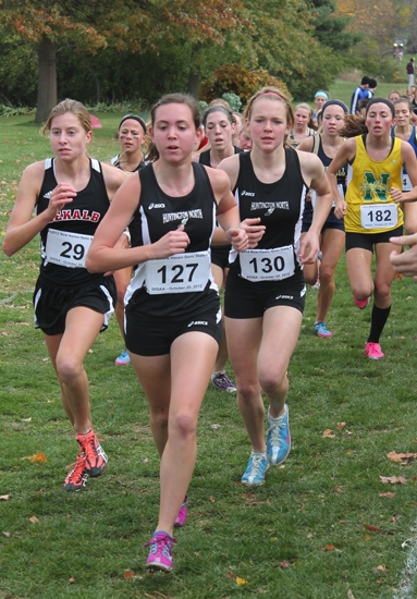 Huntington North runners Kayla Patrick (front) and Hannah Stoffel (right) lead a group of runners through a section of the course at the New Haven Semi-State Cross Country meet at The Plex in Fort Wayne on Saturday, Oct. 20.