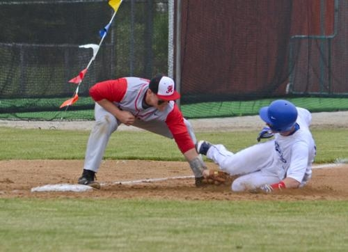 Huntington North third baseman Heaston Schwob lays the tag on a would-be Jay County base stealer during sectional action Thursday, May 23, at Huntington North. The Vikings won 10-0 to advance to Monday's second round.