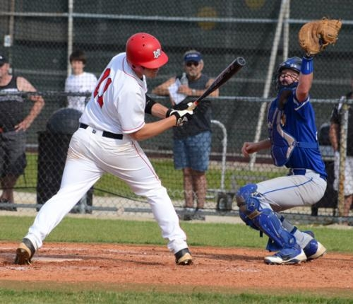 Huntington North batter Connor West twists out of the way of a high, hard one against Homestead in the Huntington North Baseball Sectional champinship game on Wednesday, May 29.