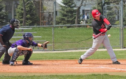 Huntington North High School senior Evan Brown makes contgact wit the ball in the second game of a doubleheader against visiting Muncie Central. The Vikings won both games.