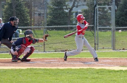 Huntington North's Derek Snyder (right) takes a swing during the varsity baseball team's game against visiting Lewis Cass on Thursday, April 17.