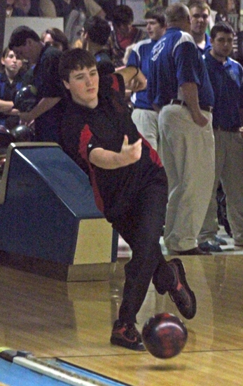 Jon Scott, a member of the Huntington North High School boys' varsity bowling team, has pins in his sights as he sends a ball down the lane in the team's match against visiting Jay County at Oak Lanes, in Huntington, on Saturday, Dec. 8.