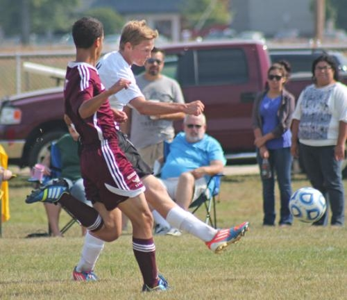 Huntington North's Brad Young (right) takes a shot in the boys' varsity soccer team game against visiting Columbia City on Saturday, Sept. 7. Young had a goal in the Vikings' 14-0 dismantling of the Eagles.
