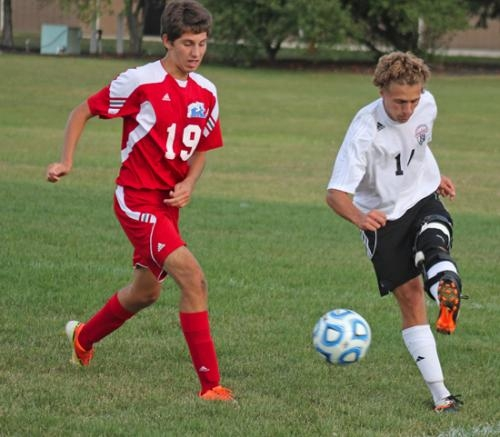 Huntington North midfielder Danny Becker passes the ball to a teammate from the right corner during play against visiting Kokomo on Tuesday, Sept. 17. The Vikings won 4-3.