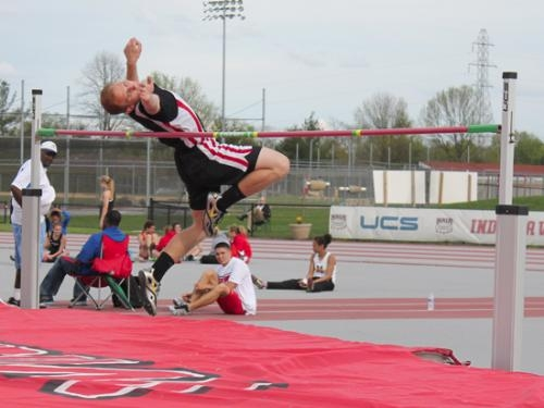 Huntington North's Houston Lehman arches his back as he flies toward the high jump bar at the North Central Conference Track & Field Championships on Friday, April 3, at Indiana Wesleyan University.