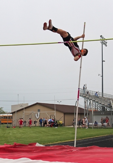 Huntington North High School senior Adam Berlier gets his legs up over the bar in pole vault during a meet at Kriegbaum Field on Thursday, May 9. Berlier won the event with a height of 11-6.