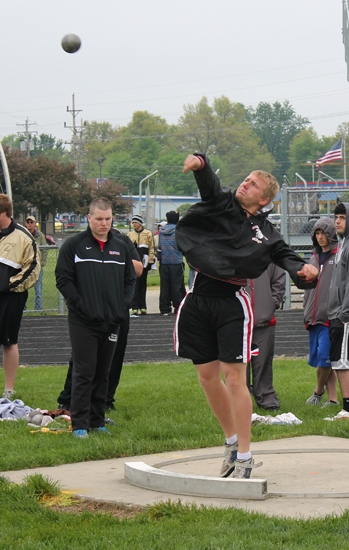 Huntington North's Layne Neal sends the shot put flying while competing in the Huntington North 9th & 10 Invitational on Saturday, May 11. Neal finished fourth in the event.