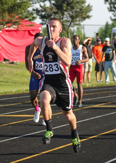 Huntington North's Andrew Sizemore turns on the jets in the 400-meter relay at the Wayne Boys' Track and Field Sectional on Thursday, May 16. Sizemore and his teammates placed fourth to earn a trip to the Wayne regional next week.