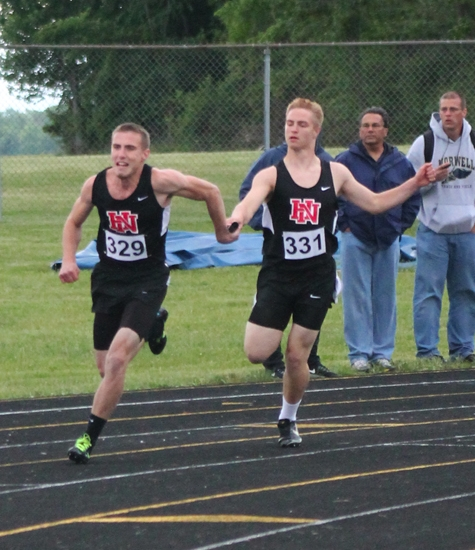Andrew Spahr (right) hands the baton to Andrew Sizemore during the 400-meter relay at the Fort Wayne Wayne Boys' Track Regional on Thursday, May 23. The quartet, which also included Drew Fawcett and Jake Shaw, placed eighth and did not advance to state.