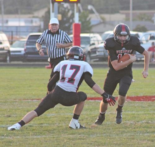 Huntington North quarterback Keenan Leichty (right) scrambles in the second quarter against visiting Logansport in the Vikings' game on Friday, Sept. 6.