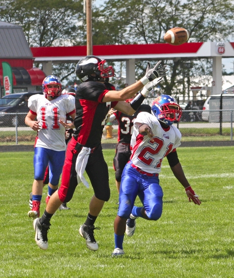 Huntington North wide receiver Paul Ehler reaches up for the football over Kokomo defensive back Rashad Gray on Saturday, Sept. 8. Ehler made the catch but the play was called back for offensive interference.