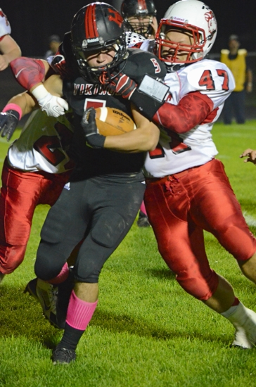 Huntington North running back Charleston Dydasco takes a hit from Richmond linebacker Morgun Bragg and keeps going during the Vikings' 35-16 win over the visiting Red Devils on Friday night, Oct. 11.