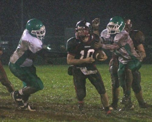 Viking quarterback Drew Schnitz looks for running room against visiting Fort Wayne South Side on Friday night, Oct. 19, in sectional action. The Vikings' season ended with a 14-6 loss.