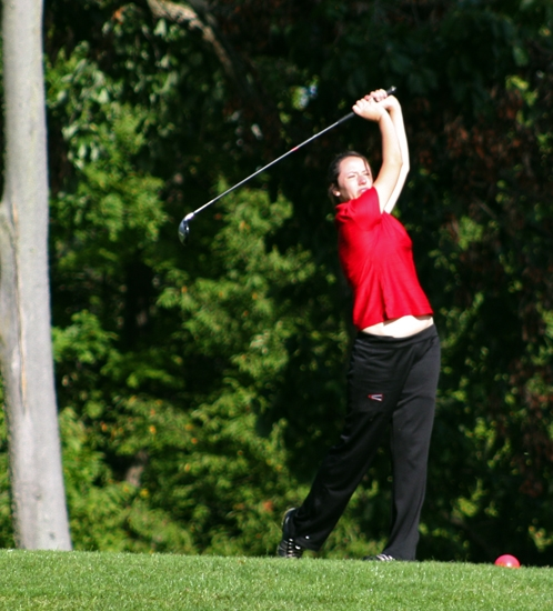 Huntington North junior Lauren McCullough follows through on a tee shot at the Huntington North Girls' Golf Regional on Saturday, Sept. 15.